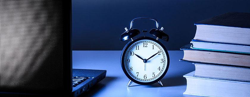 Clock On Desk Books Laptop Night