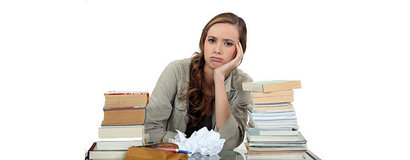Girl At Desk Books Frustrated Head On Hands