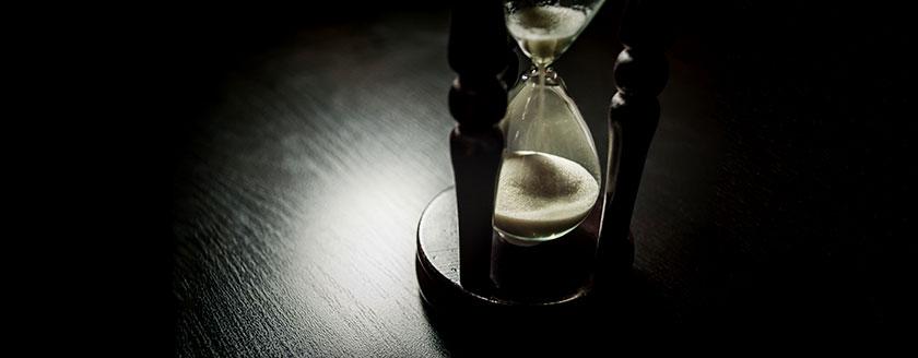Hourglass On Dark Wood