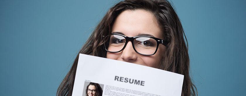 Woman Holding Her Résumé