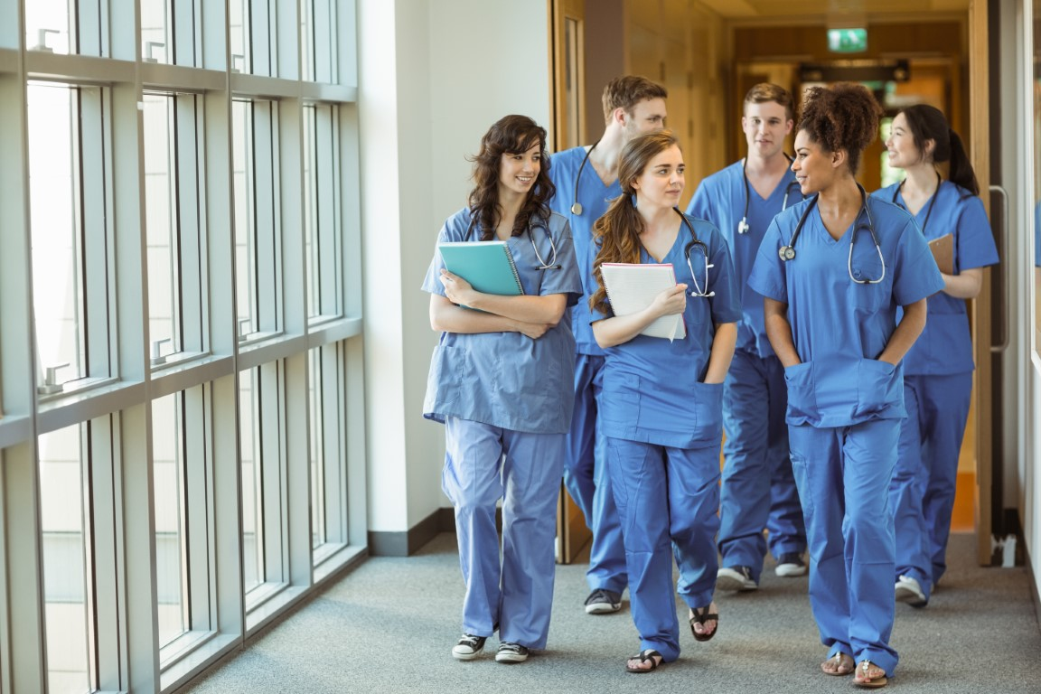 MedicalStudents Walking Through Corridor